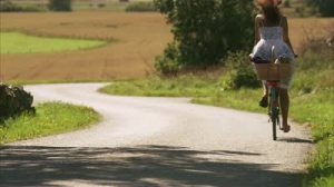 stock-footage-a-woman-riding-a-bike-in-the-swedish-countryside