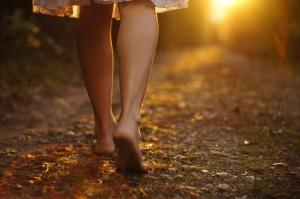 woman-walking-down-path-shutterstock_92746561