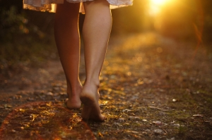 woman-walking-down-path-shutterstock_92746561
