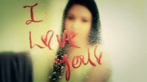 stock-footage-pretty-girl-erases-lipstick-on-mirror-i-love-you-a-beautiful-woman-wipes-off-the-words-i-love-you