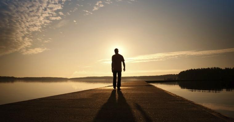 13235-man-alone-walks-water-path-road-sky-clouds-horizon-1200w-tn