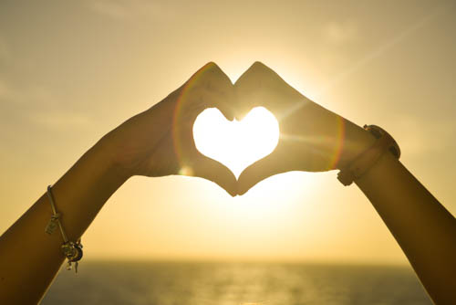 Love-Heart-Made-With-Hands-At-Sunset_1