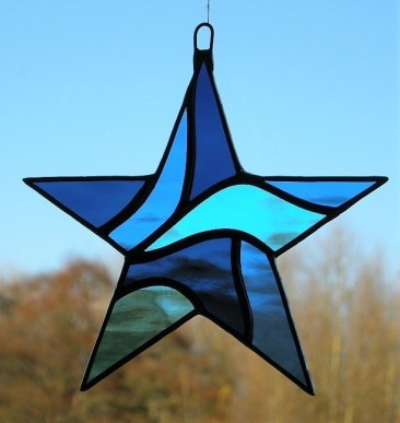 7209137-Stained-Glass-Star-Abstract-in-three-different-blues-rippling-water-glass-0